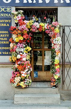 A doorway of flowers.