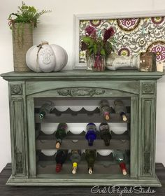 Using a new fireplace frame, - Fireplace is Beautifully created Into an Aged Wine Rack