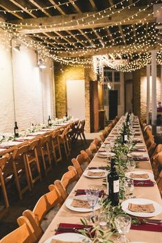 Rustic tables with olive branch table runners for a quirky London warehouse wedding with a pizza van reception at Brixton East http://www.babbphoto.com