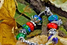 trollbeads+city+bead+collection | Ganesha and the Head of Buddha on the new Orange/Navy leather bracelet ...