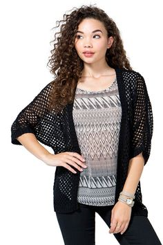 Perfect for this in-between weather days, this cocoon cardigan features an open knit construction and an open front. Half sleeves. Ribbed knit trimming. Lightweight. $19.50