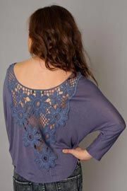 A beautiful lace detail on the back can revamp any old t-shirt or sweater.
