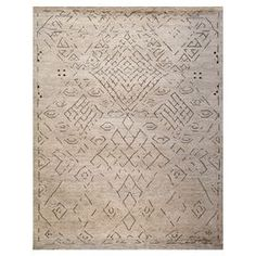 Wool-blend rug in cream and slate with tribal diamond detail.  Product: RugConstruction Material: WoolColor: Cream and slateDimensions: 8' x 10'Note: Please be aware that actual colors may vary from those shown on your screen. Accent rugs may also not show the entire pattern that the corresponding area rugs have.Cleaning and Care: Clean with mild soap and a soft, dry cloth. Avoid strong cleaning products. Vacuum regularly.