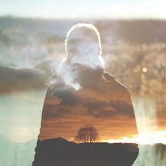 this double exposure image uses a sunset in the background and a person in the foreground however the tree is still the subject of the image Eckhart Tolle, Double Exposure Photography, Art Photography, Conceptual Photography, Outdoor Photography, A Course In Miracles, Spiritus, Multiple Exposure, Thing 1