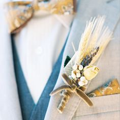 """Don't you LOVE this wheat boutonniere? """"Go Green"""" for your wedding with plant decor! Check out more lovely plant Etsy wedding finds for an eco-friendly wedding! 3d-memoirs.com"""