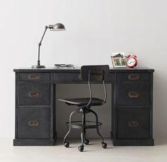 RH TEEN's Industrial Campaign Storage Desk:Inspired by ever-practical 19th-century campaign furniture, our enduring steel desk features multiple storage drawers, metal corner brackets and inset drawer pulls.
