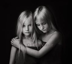 This is a lovely photo.  I do not think children always have to be smiling in their photos -- this is beautifully done! By Lisa Visser Fine Art Photography)