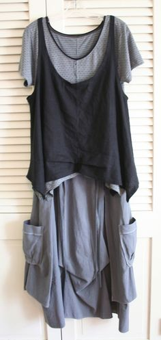 I'm going to make this skirt in lightweight, dark wash denim.  *Love* the tiny front waist pleats.