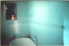 Nan Goldin Self Portrait in blue Bathroom, London.