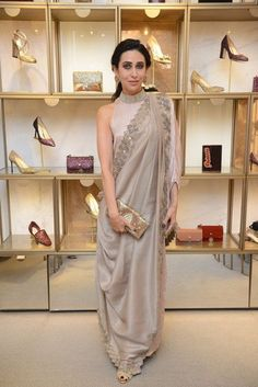 Karisma Kapoor is quite a shape-shifter when it comes to her wardrobe choices. Check out her best looks, from draped sarees to kurtas and gowns, from Saree Draping Styles, Saree Styles, Stylish Sarees, Stylish Dresses, Indian Wedding Outfits, Indian Outfits, Indian Designer Outfits, Designer Dresses, Indian Gowns Dresses