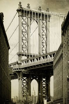 Manhattan Bridge--and the Empire State Building is visible under the little arch underneath the bridge.