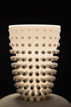 The Hedhog insulation cup, made out of 3D printed Polyamide. The inner cup is the container to hold the liquid, the outer cup is former trough pins, creating a skin of air between your hot drink and your hands. The pins get smaller at the top of the cup towards the rim so you can feel with your lips whether the drink is too hot or not!