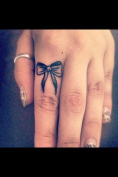 My finger tattoo, a bow
