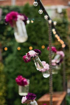 LOVE these hanging bottles of flowers from the string lights....how pretty would that look in the garden at CJ's Off the Square?!?!    UHM I am OBSESSED with this!!