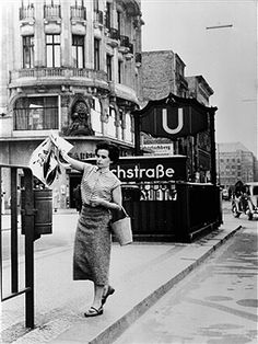 Germany, Berlin: Underground station Kochstrasse / Friedrichstrasse. A woman throws away her West-Berlin newspaper before entering the soviet sector (East-Berlin) - 1956