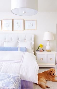 White bedroom with lavender accents. Home of Dallas interior designer Cynthia Collins.