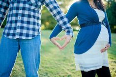 i love this! Our hands making a heart...cute maternity or engagement photo