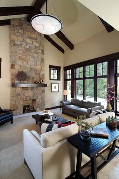 Stone in fireplace.  Contrasting dark wood with light walls and floor