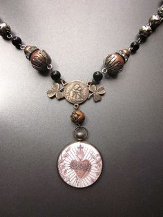 Hey, I found this really awesome Etsy listing at http://www.etsy.com/listing/152687041/religious-sacred-heart-necklace