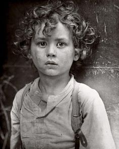 +~+~ Antique Photograph ~+~+ This is my favourite photograph by Lewis Hine taken in 1918. A young boy with such a cherubic face and a headful of curls - sent to work far too young in life. His sweet, soulful, exhausted expression is haunting.