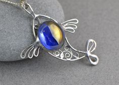 Stained glass pendant blue fish pendant stained glass necklace- Celtic jewelry glass wire filigree beautiful gift unique jewelry fishing by OrioleStudio on Etsy https://www.etsy.com/listing/172976484/stained-glass-pendant-blue-fish-pendant
