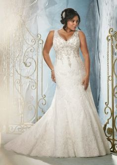 Curves in all the right places with this plus size #weddingdress - Find more like this at http://www.myweddingconcierge.com.au