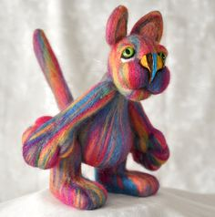 "Hi from Kotoyama!  A felted artist cat with adorable smile, long tail and sweet big green eyes.  Can stand and sit. When stands he is a whole 18.5 cm (7.5"") tall.  Kotoyama is made from fine Merino wool with glass safety eyes."