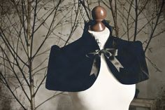 Victorian inspired velvet capelet or bolero with lace ruffle and satin bow.