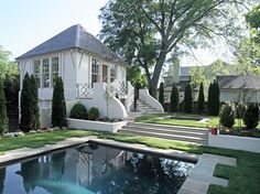 Every detail is exquisite of this garage & pool house!  Pool & Garden Pavilion from PursleyDixon.