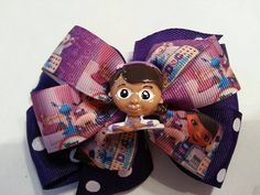 """5"""" Doc inspired double layer pinwheel bow on a lined alligator clip with a no slip grip or french barrette. 5.50 each"""