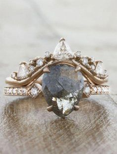 A one-of-a-kind engagement ring featuring a pear-shaped diamond paired with a stunning crown-shaped band. wedding bands Tempest: Intricate Wedding Ring with Trillion & Round Diamonds Unique Wedding Bands, Wedding Jewelry, Wedding Ideas, Custom Wedding Rings, Vintage Wedding Ring Sets, Crown Wedding Ring, Boho Wedding Ring, Dream Wedding, Wedding Bride