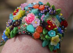 beaded cuff, beautiful... would take lots of patience!   sewn on ultrasuede