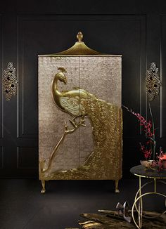 Designed passionately and exquisitely by the incomparable talents powering Koket. The Camilia was created to grace the most regal of dining rooms with its elegance and splendor. Inspired by the aristocratic palaces of the Alexandrian pashas of Egypt, the mother of pearl Camilia is crowned by artisan hand-carved peacock, meticulously engraved and delicately finished in gold leaf. The structure is adorned with mother of pearl, opening to antique mirror finish.