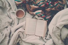 To not get bored on snowy/rainy days i like to grab a big blanket, hot chocolate and a book.