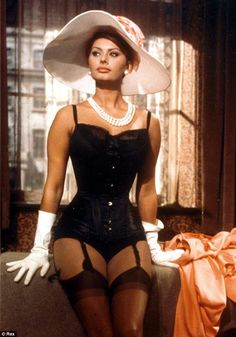 Siren: Sophia Loren rose to fame in films such as Yesterday, Today and Tomorrow (1963)... http://dailym.ai/1i9Xgv5#i-aae70e77