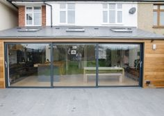 This installation on the coast in Whitstable, Kent, came to us as a result of installing grey windows previously. We installed grey aluminium sliding doors.