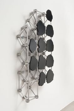 Mark Hagen, To Be Titled (Subtractive and Additive Sculpture #8), 2012. Rainbow Obsidian on Aluminum and Stainless Steel Space Frame. 36 x 48 x 6 inches  (91.4 x 121.9 x 15.2 cm)