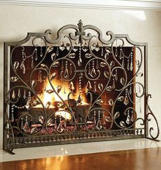 Make your living room sparkle this winter with an elegant fireplace screen that's dripping with crystals