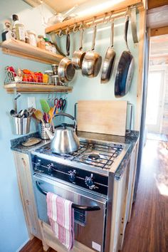 Tiny House Kitchen contemporary kitchen - amazing what you can hang near the stove in a very small space