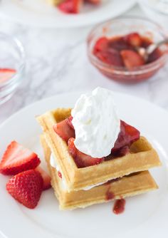Easy Coconut Waffles recipe made with a buttermilk pancake mix and topped with strawberry rhubarb compote.