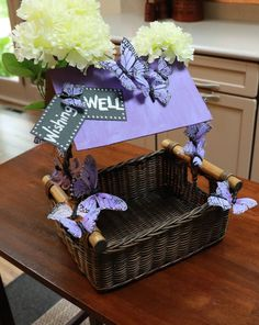 DIY Tabletop Wishing Well--This is perfect for any baby or bridal shower! Shop this basket and get step-by-step directions to recreate this for your next shower at www.basketlady.com