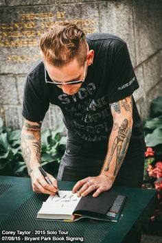 Corey Taylor doing a book signing during his solo tour, July 2015
