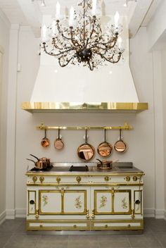 Chandelier and white cooker hood Kitchen