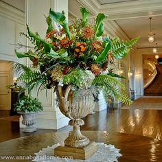 Flower arrangement with greens, browns, creams and rusts