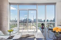 Liberty Central-51 East Liberty St #PH04  | Must see one-of-a-kind 1100 + sf 2 bedroom, 2 bath + den + 2 parking & 2 lockers Penthouse curve suite with fab pano CN tower/city/lake views! . Also includes 2 premium parking/storage locker combo units on P1. More info here: torontolofts.ca/liberty-central-lofts-for-sale/51-east-liberty-st-ph04 Lake View, Lofts, Cn Tower, Lockers, Den, Locker Storage, Liberty, The Unit, Windows