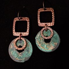 Artisan earring #58...Antique Chinese coin with beautiful green patina and rustic hammered copper hoops. These are fairly large earrings but are not terribly heavy for their size. The copper is beautiful with the green patina on the coin. The man that I got these coins from 30 years ago