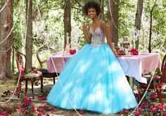 Prom Dresses by Morilee designed by Madeline Gardner. Embroidered Tulle Prom Ballgown with Deep-V Neckline and Basque Waist. Beaded Bodice and Straps and Skirt.