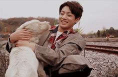 Jungkook happily playing with a dog during the I Need U MV shoot brightens my whole day.
