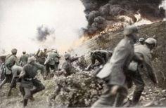 German soldiers using a flamethrower during an assault at Verdun, 1916.