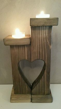 Hand made pair of tall rustic wooden tea light candle holders with heart shaped cut out.     In a dark stain and waxed    H19cm   H24cm x D7cm x W14cm    Tea lights are not supplied   eBay!